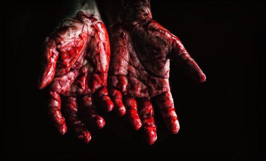 bloody hands dark background