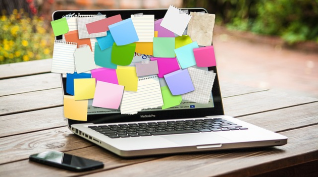 laptop with post its