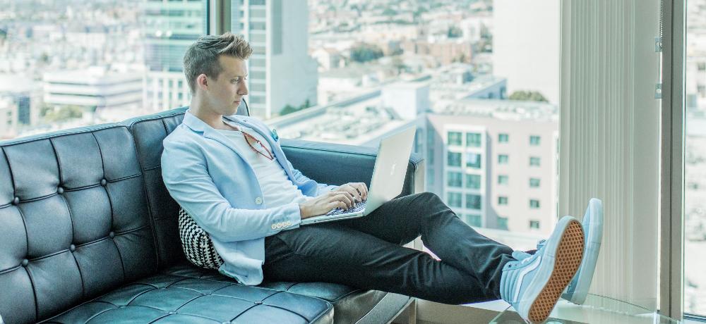 man sofa laptop highrise austin distel
